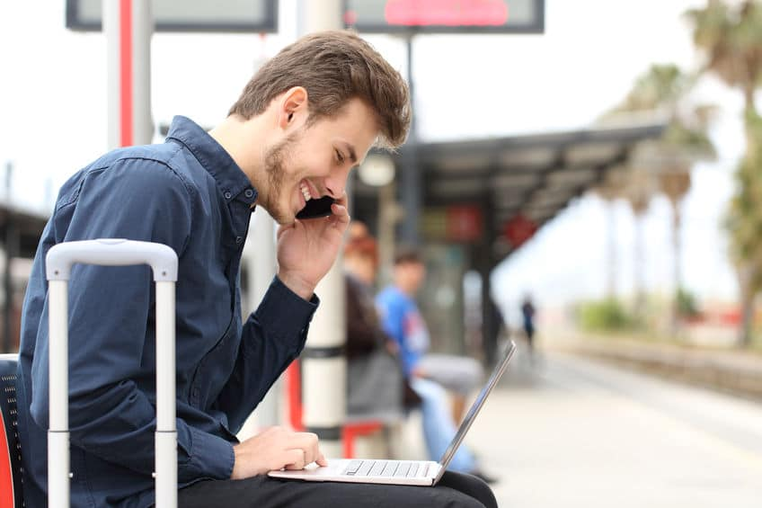 Traveler using over the phone interpretation while waiting for a bus